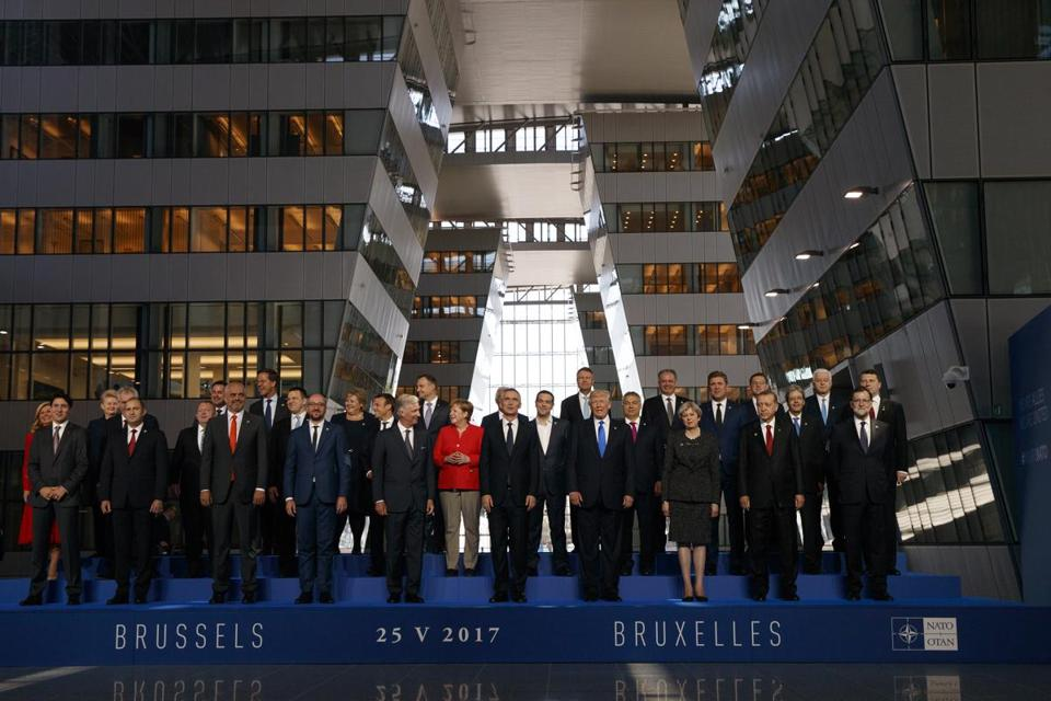 President Donald Trump posed with NATO leaders in Brussels on Thursday.
